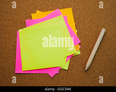 Many and colorful post note attach on wood board with wooden pencil - Stock Photo