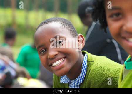Young Ugandan female school child smiles at camera - Stock Photo