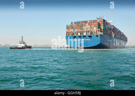 The Giant CMA CGM Centaurus Container Ship Is Manoeuvred Into The Long Beach Container Terminal, California, USA. - Stock Photo