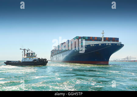 The Giant, CMA CGM Centaurus, Container Ship Is Manoeuvred Towards Pier J In The Long Beach Container Terminal, - Stock Photo
