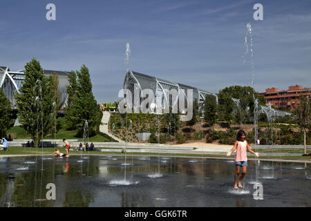 Water fountains in a park on the Rio Manzanares, Madrid, Spain - Stock Photo