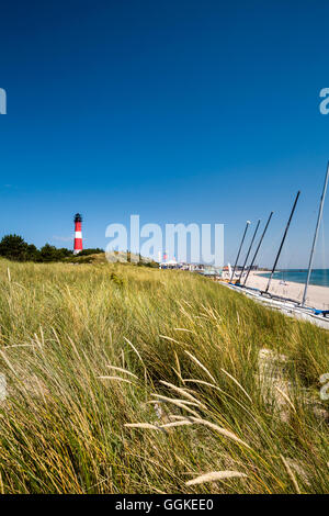 Beach and lighthouse, Hoernum, Sylt Island, North Frisian Islands, Schleswig-Holstein, Germany - Stock Photo