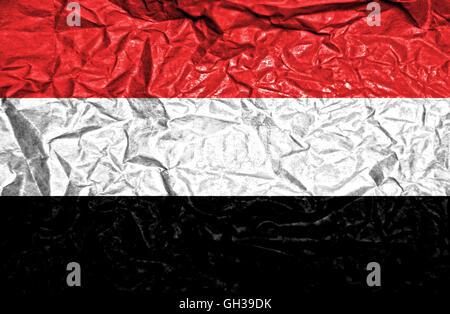 Yemen vintage flag on old crumpled paper background - Stock Photo