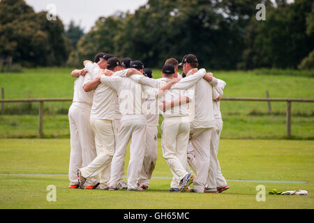 Worfield Cricket Club players during a match against Streetly Cricket Club at Davenport Park, Shropshire, England, - Stock Photo