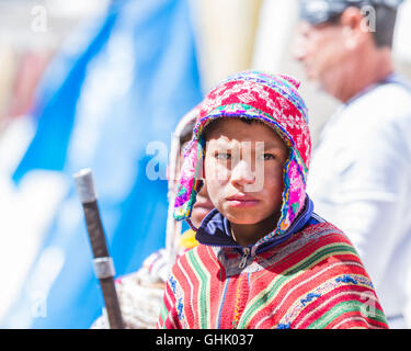Pisac, Peru - May 15: Young man dressed in beautiful traditional clothing in the Pisac Market. May 15 2016, Pisac - Stock Photo