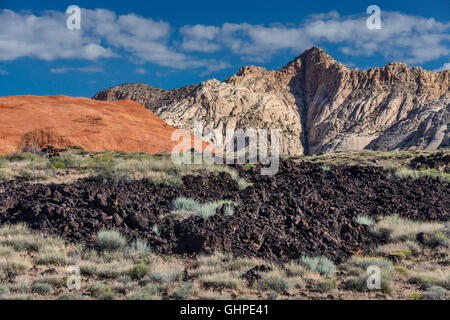 Lava rocks, white and red Navajo Sandstone rock formations, Lava Flow Trail at Snow Canyon State Park, Utah, USA - Stock Photo