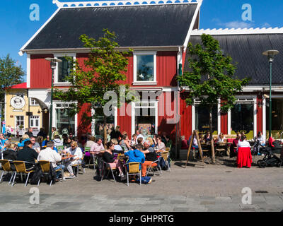 Visitors dining out in sunshine Reykjavik historic City Centre Iceland's capital city - Stock Photo
