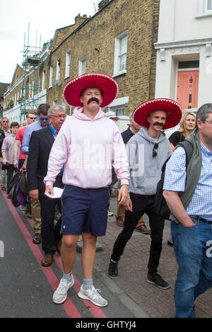 Vauxhall London UK. 11th August 2016. Cricket fans dressed wearing Mexican sombreros arrive for the fourth test - Stock Photo