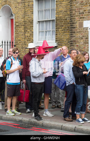 Vauxhall London UK. 11th August 2016. Cricket fans wearing colourful Mexican sombreros arrive for the fourth test - Stock Photo