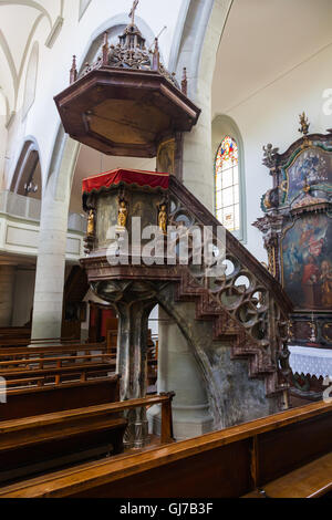 Carved ornate pulpit of the Saint Maurice Church in Fribourg, Switzerland - Stock Photo