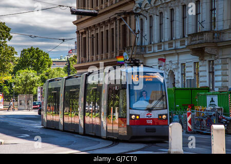 Gay rainbow flag waving on a tram during the Gay Pride Day, Vienna, Austria - Stock Photo