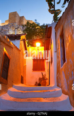 Acropolis as seen from the streets of Anafiotika, Athens. - Stock Photo