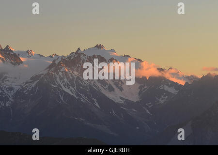 Sunset on Aguille du Tour in the Mont Blanc Massif seen from Cabane Montforte above Verbier, Switzerland - Stock Photo