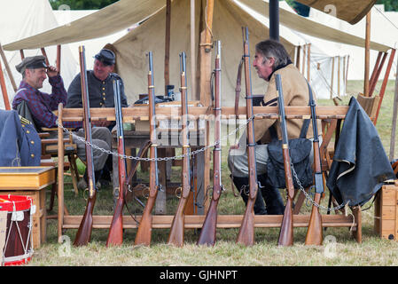 Confederate Soldiers muskets in an encampment of a American Civil war reenactment at Spetchley Park, Worcestershire, - Stock Photo