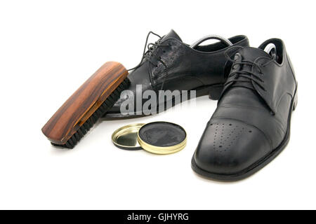 cleaning shoes - Stock Photo