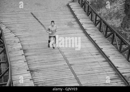 black and white one man runner jogger elevated view above high - Stock Photo