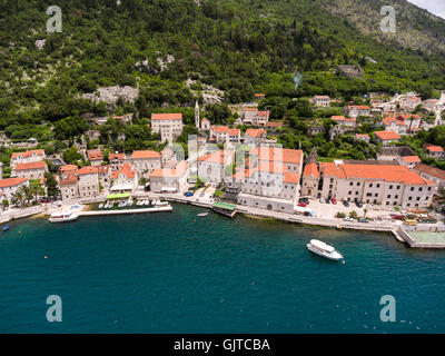 Shore of Perast town with St. Nicholas church in center. Aerial view. Adriatic sea. Kotor bay (Boka Kotorska), Montenegro - Stock Photo