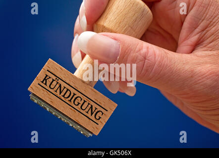 termination - stempel mit hand - Stock Photo