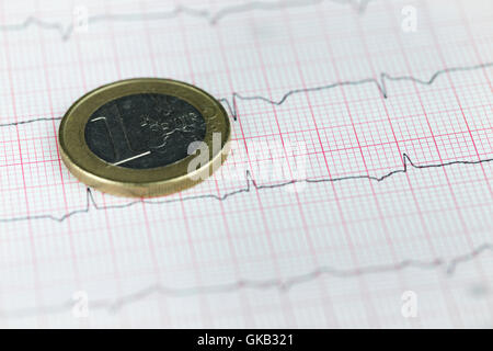 One euro coin over financial graph, economy concept - Stock Photo