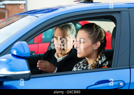 young woman in a driving school car - Stock Photo