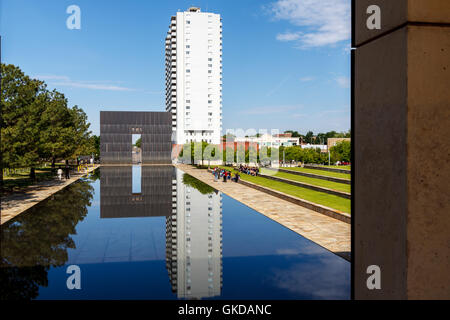 The reflecting pool and the 'Gates of Time' at the Oklahoma City Bombing Memorial. - Stock Photo