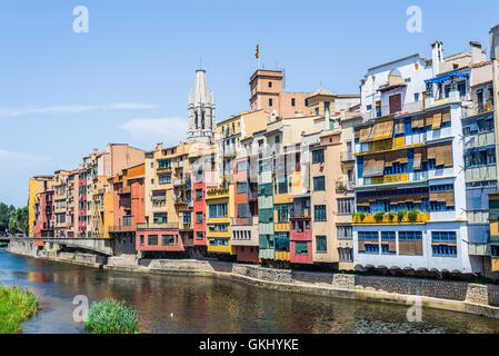 Onyar river crossing the downtown of Girona with bell tower of Basilica of Sant Feliu in backgrou - Stock Photo