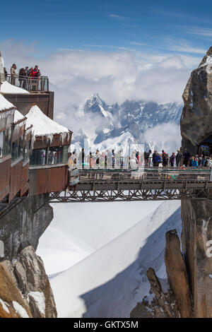 View from Aiguille du Midi on terraces tourist platform where commute highest cable car in Europe. - Stock Photo
