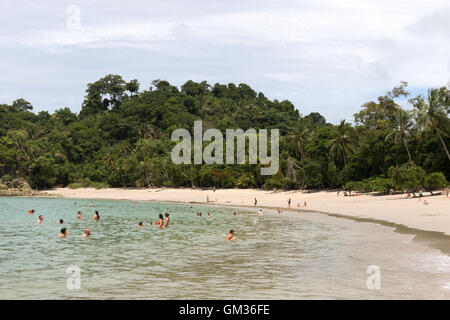 Tourists bathing in the Pacific Ocean, Manuel Antonio national park beach, pacific coast, Costa Rica, Central America - Stock Photo
