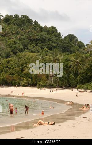 Sunbathers on the beach, Manuel Antonio National Park, Pacific coast, Costa Rica, Central America - Stock Photo