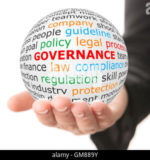Hand take white ball with red inscription governance - Stock Photo