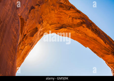 Low angle view of natural arch against clear sky - Stock Photo
