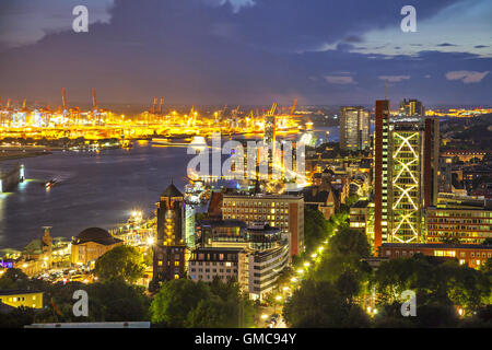 Buildings in the riverside of Elbe at the evening, Hamburg, Germany - Stock Photo
