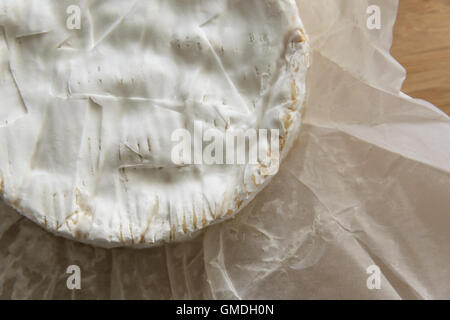 Camembert cheese on a wooden board - Stock Photo