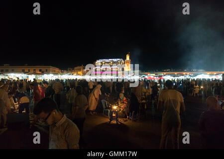 Djemaa el fna market in Marrakech, Morocco at night - Stock Photo
