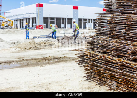 Spikes of rebar grid, reinforcing mesh, steel bars stacked for construction. - Stock Photo