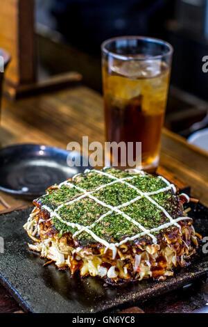 Okonomiyaki, Osaka, Japan - Stock Photo