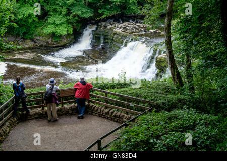 Tourists at the Aysgarth Falls, Wensleydale in the Yorkshire Dales. - Stock Photo