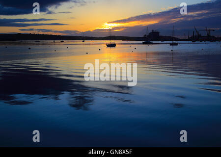 Sunrise over the Carrick Roads at high tide, Falmouth, Cornwall, England, UK. - Stock Photo