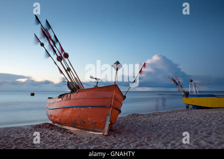 Boats and ghosts on the beach. - Stock Photo