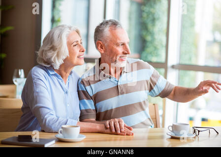Pleasant senior loving couple resting in the cafe - Stock Photo