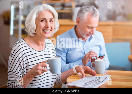Joyful woman resting in the cafe with her husband. - Stock Photo