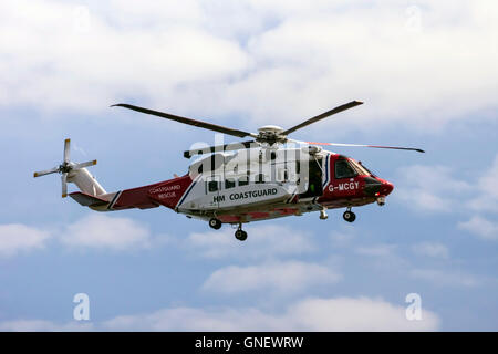 Coastguard SAR Helicopter G-MCGY operated by Bristow Helicopters off the Coast of Cornwall - Stock Photo