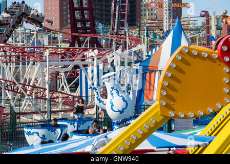 View of rides in Luna Park fairground on Coney Island, New York. - Stock Photo