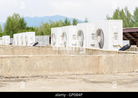 Air compressors machine on roof of industrial building - Stock Photo