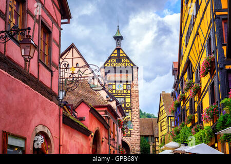 Colorful houses on a central street in Riquewihr, village on wine route in Alsace, France - Stock Photo