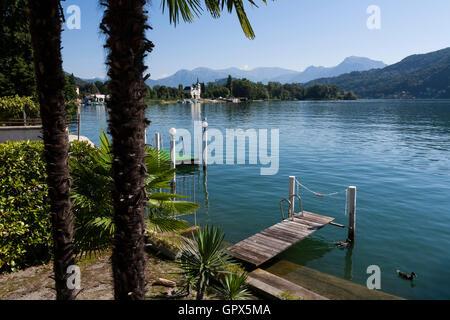 Private jetties on Lake Lugano in Caslano, Switzerland. - Stock Photo