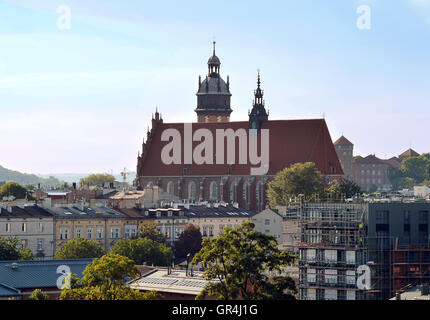 Evening view across the rooftops of Krakow to the Corpus Christi Basilica, founded in 1335. - Stock Photo