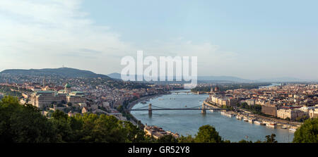 View over the old town of Budapest and the Danube River from Gellert Hill in the early evening, Budapest, Hungary - Stock Photo