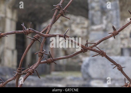 Rusty Barbed Wire On Old Italian War Fortifications - Stock Photo