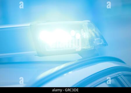 Flashing Blue Light Of A German Police Car - Stock Photo